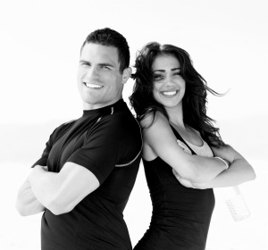 Smiling young couple with arms crossed
