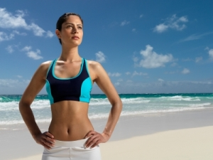 Young woman on a beach ready to start a workout.